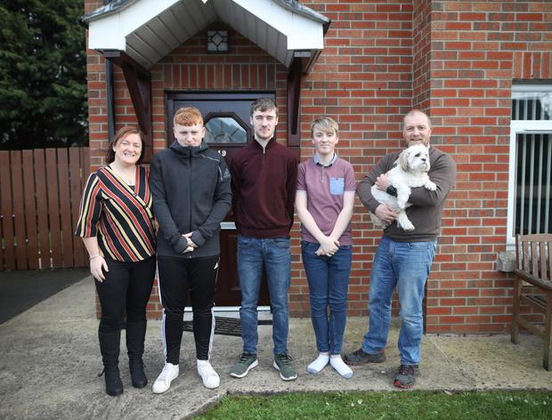 Monica with husband Colin and sons Nathan, Callum, Matthew and dog Buddy