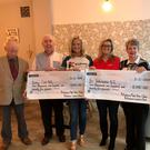 On song: Jo-Anne Dobson (third left) with Gordon Speers (second left) and representatives of the Portadown Ladies and Male Voice Choirs present charity cheques to Kidney Care UK and Air Ambulance