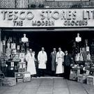 Early days: staff outside an early Tesco store