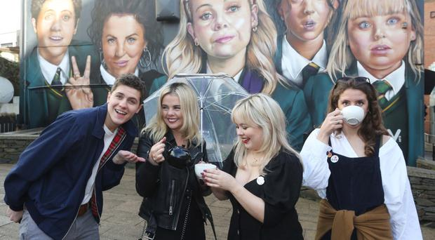 Off the wall: Derry Girls cast members Dylan Llewellyn, Saoirse-Monica Jackson, Nicola Coughlan and Louisa Harland visiting the new mural