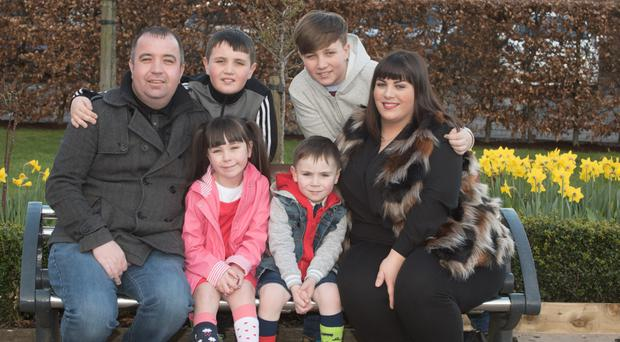 Staying positive: Brian and Cheryl Tierney with children Shane, Cian, Mary-Kate and Ben