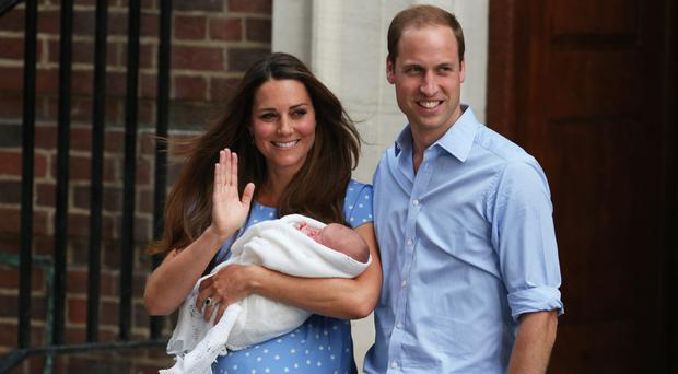 Royal tradition: the Duchess and Duke of Cambridge with their first child, Prince George.