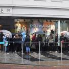 People brave the elements for the opening of the new Primark store in Donegall Place in Belfast