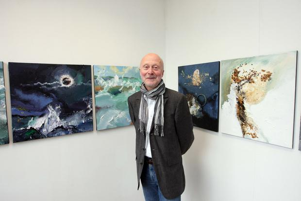 Personal exhibition: Leslie with some of his works