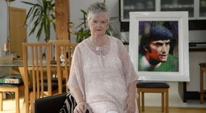 Precious memories: Barbara McNarry with a picture of her late brother George Best