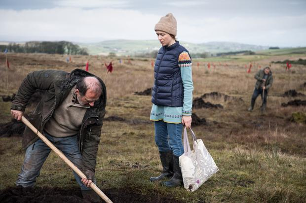 Digging deep: a scene from The Dig featuring Lorcan Cranitch and Emily Taaffee