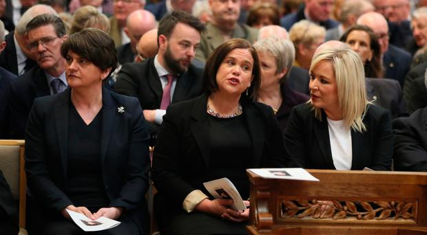 DUP leader Arlene Foster with Sinn Fein's Mary Lou McDonald and Michelle O'Neill before the funeral service for murdered journalist Lyra McKee at St Anne's Cathedral, Belfast
