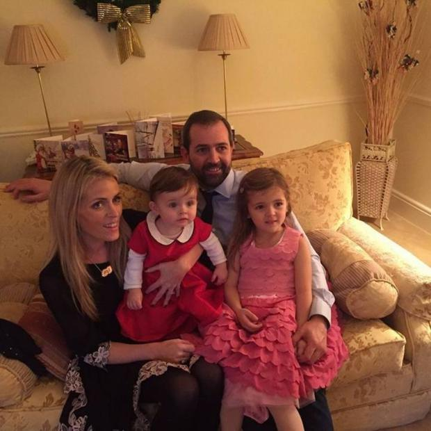 The couple at home with daughters Freya and Robyn