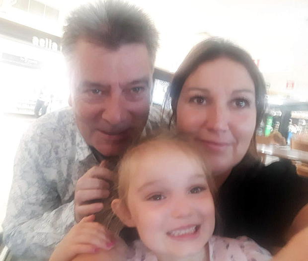 John enjoying precious family time with wife Claire McNeilly and their daughter Soley