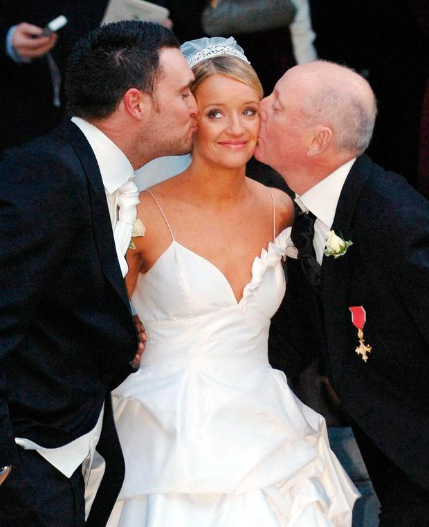 Jasper Carrott giving his actress daughter Lucy Davis a kiss after she married Welsh actor Owain Yeoma in 2006