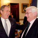 Bridging divides: from left, David Trimble, George Bush and Seamus Mallon