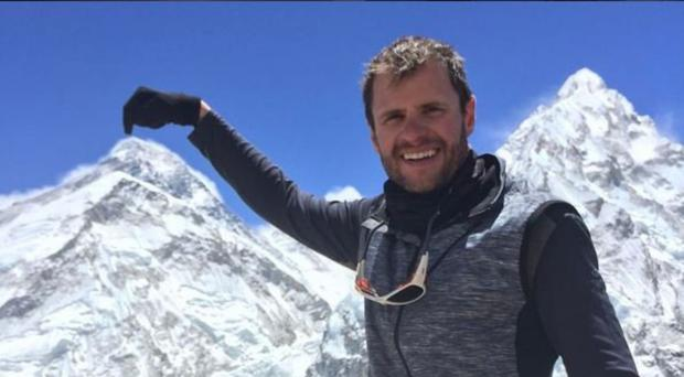 High life: hotelier and adventurer John Burke points out the summit of Everest as seen from Pumori High Camp in May 2017