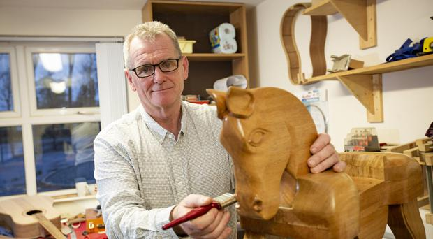 Peter making a rocking horse for his granddaughter