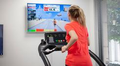 Immersive experience: Liz Connor running on a treadmill while testing out the Zwift running app
