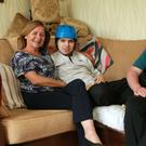 Caring couple: Lynne and John McKenzie with son Adam