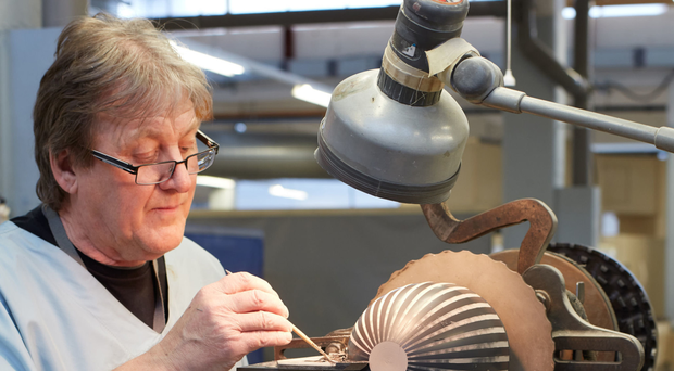 Keen eye: a craftsman at work in Wedgwood's Barlaston factory near Stoke