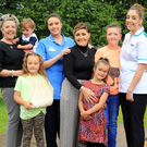 Sara Mehaffy, Kim Murdock and Kellie Mehaffy and their mum Debbie (left) holding Jude (21 months), Kim, Kellie and Sara with Harlow (7), Kaleb (10) and Willow (6)