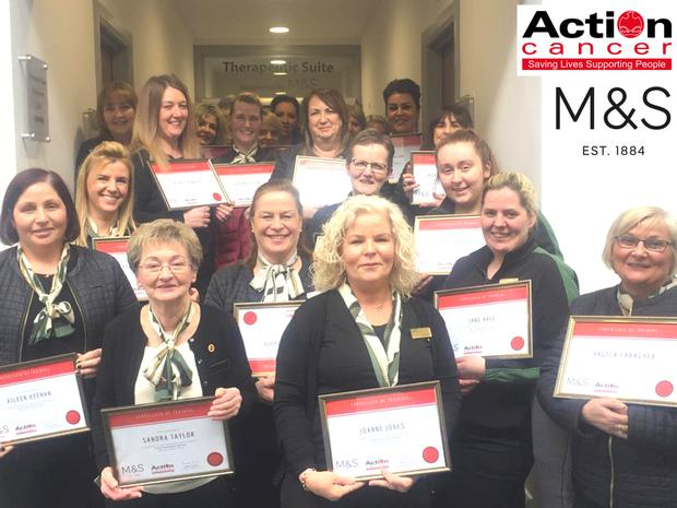 Vital role: M&S staff receiving their cancer awareness training certificates