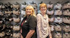 Expert advice: Pat Maguire, Marks & Spencer bra fit adviser, and Suzi Waterworth, who says Action Cancer saved her life