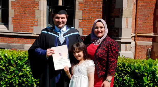 Ihsan Baleed shows his QUB degree in Computer Science with his mother Abir and sister Nadin