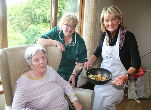 Universal language: resident Anne Glover and head housekeeper Dianne Knox with Jenny
