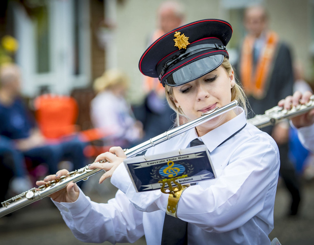 A flute band parades on the Twelfth
