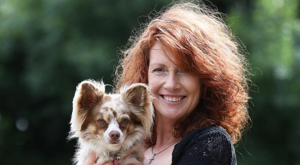 Joanne Cairns who runs Petticoat Tails, holds her dog Vernon