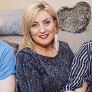 Family support: Lynda Bryans at home with husband Mike Nesbitt and their sons Chris and Peter