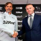 Derby County boss Phillip Cocu welcomes Wayne Rooney to Pride Park