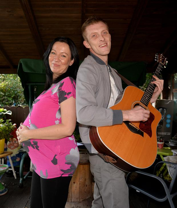 John Andrews with his Polish fiancee Kasia Zyczynska, who is seven months' pregnant