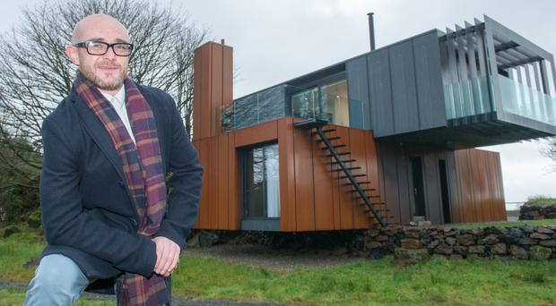 Self-contained: Maghera-based architect Patrick Bradley by his house, which was featured in TV show Grand Designs