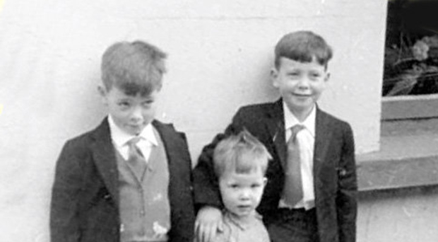 John (left) on the left of his brothers Paul (centre) and Gerry on his first day