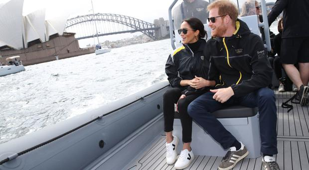 Royal approval: the Duchess of Sussex wearing a pair of Veja trainers