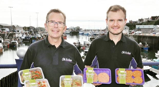 Sean Morgan and son Connor with some of their Oh So Lean products