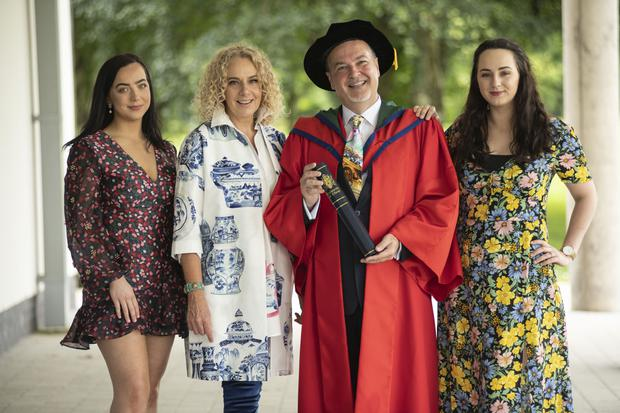 Tony Macaulay receives an honorary degree of Doctor of Letters from Ulster University with his wife Lesley and daughters Hope and Beth