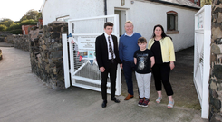 Carol Magill with her partner Colin Simms and their children Daniel (9) and William (14) outside the former coastguard boat house
