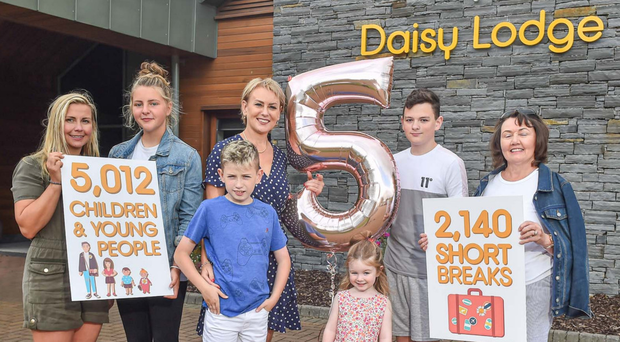 Special milestone: Nola Harrison, daughter Zara, Barbara Rooney and her sons, Pierce, James and granddaughter Elsie-Mae, and friend Mary O'Neill celebrate Daisy Lodge's fifth birthday
