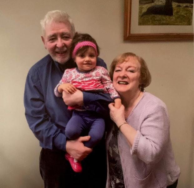 Cherished memories: Eamon Friel with his wife Caitlin and granddaughter Milla