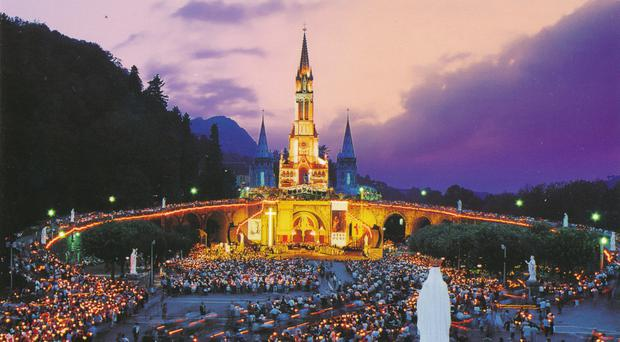 Night vision: a torchlight procession at Lourdes