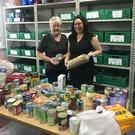 Charity work: Colleen Tinnelly and colleague in a pet food bank