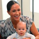 Real struggle: being a new mum is not all smiles and laughter as the Duchess of Sussex has found out with son Archie Mountbatten-Windsor
