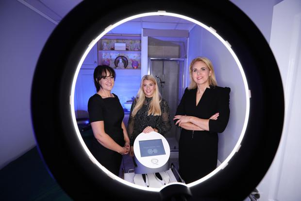 Life balance: Lisa (right) with spa manager Catherine McCann and Katey McTavish from AES with the Divine Pro