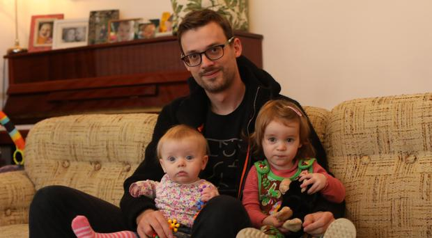 Sebastian Heinz at home in Comber with his daughters Mavyn and Romy