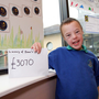Amazing effort: Isaac Corney with the £3,070 he raised for the new minibus