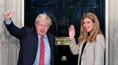 Under scrutiny: Prime Minister Boris Johnson and his girlfriend Carrie Symonds at 10 Downing Street yesterday