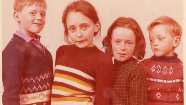 Above from left, John (far left,as a child with sisters Jane, Theresa, (renamed Alison) and his brother Francis, (renamed James).