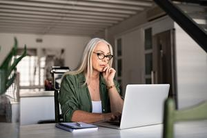 Expert advice: a woman working at home on her laptop