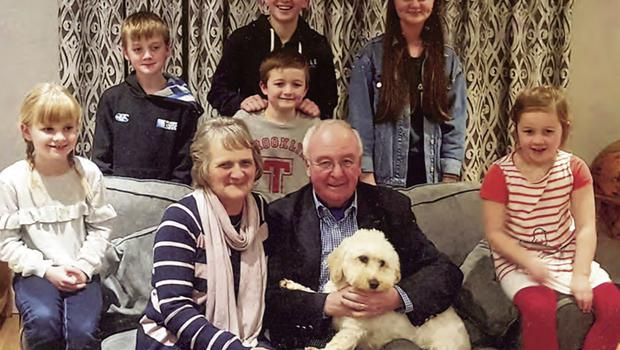 Jim with his wife Carol and their grandchildren