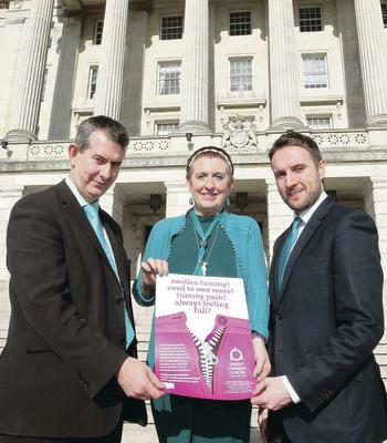 Una with Health Minister Edwin Poots (left) and the Alliance Party's Chris Lyttle in front of Stormont