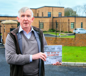 Mystery man: George Busby with his book at the former spy station